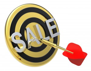Red dart on a gold target with text on it. The concept of sales and occasion.